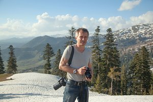 Nature photographer with two digital cameras in the mountains