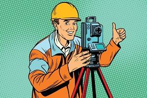 Builder surveyor with a theodolite optical instrument for measur