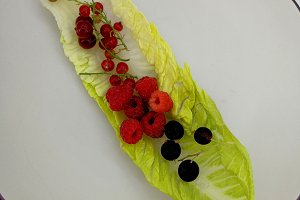 Cherries, berries and lettuce leaf
