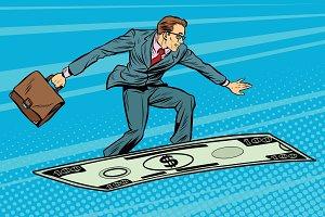 Businessman on flying money carpet plane