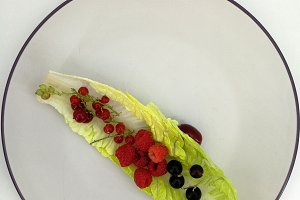 Lettuce leaf with berries