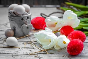 White tulips with pot and red Easter eggs