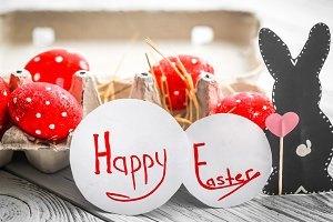 Red Easter eggs and rabbits