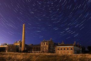 abandoned sugar factory at night