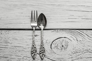 vintage Cutlery on white wooden background