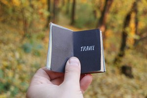 Travel agent idea, book and text