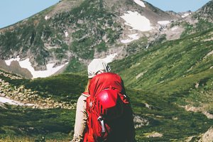 Backpacker hiking at mountains