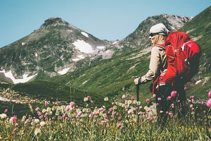 Woman explorer hiking at mountains