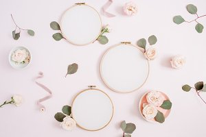 Embroidery frames with beige roses