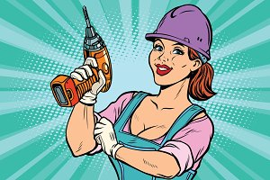 Construction worker with drill. Woman professional