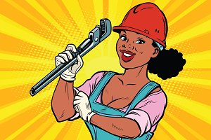 Construction worker with adjustable wrench. Woman professional