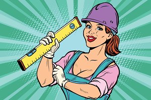 Construction worker with level. Woman professional