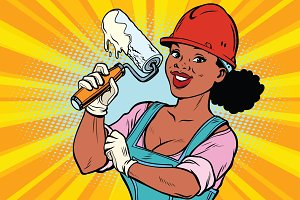 Construction worker with roller for paint. Woman professional