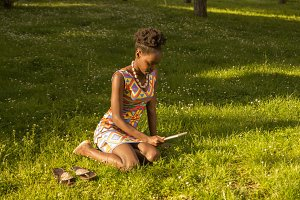 one young black woman outdoors