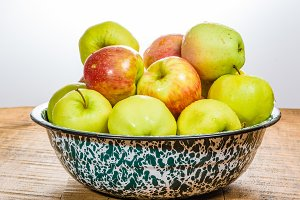 Bowl of organic apples on table