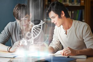 Smiling college students analysing dna on digital interface