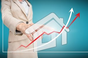 Businesswoman touching futuristic house interface with graph