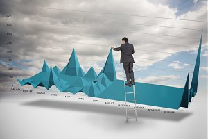 Businessman on a ladder catching the tip of a chart
