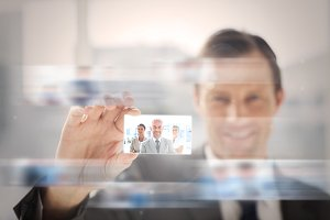 Pleased businessman presenting a picture of business team