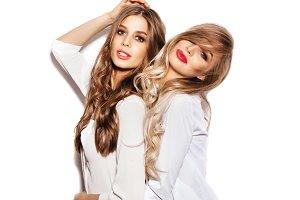 two pretty girls wearing white shirts