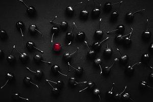 red cherry on black backround cherry