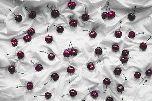 dark red cherry on white background