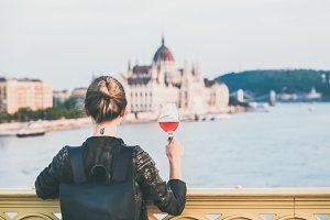 Woman, Budapest & glass of rose wine