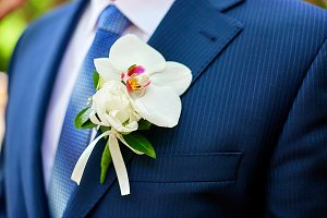 Boutonniere pinned to blue jacket