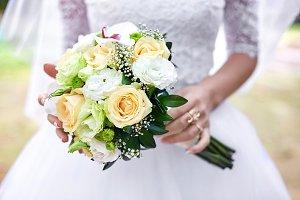 Bride's hold gorgeous bouquet