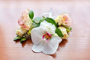 Boutonnieres made of white orchids