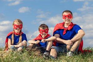 Dad and children playing superhero