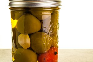 Pickled hot peppers in mason jar