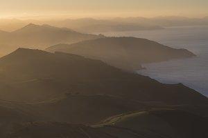 rolling hills at sea side landscape
