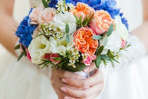 Wedding bouquet in hands bride