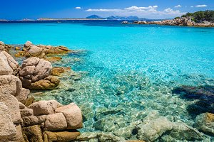 Clear amazing azure coloured sea water with gtanote rocks in Capriccioli beach, Sardinia, Italy