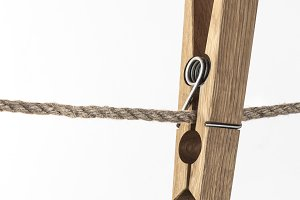 Wooden clothespin on rope