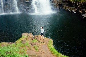 Winner near waterfall.