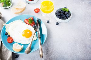 Fried egg and orange juice