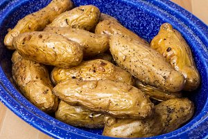 Dish of fingerling potatoes baked in oven
