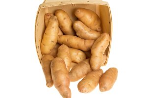Box of fingerling potatoes isolated on white