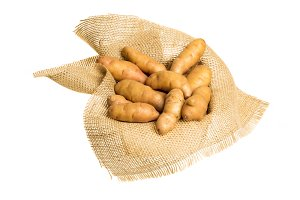 Fingerling potatoes on burlap isolated