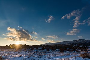 Cloudy sunset in snow field