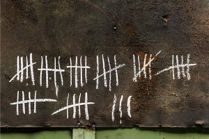 Counting with strikes on chalkboard