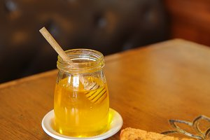 Glass jar of honey.
