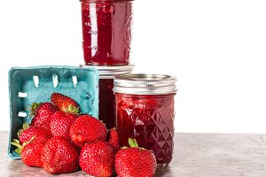Fresh strawberries preserved in jars