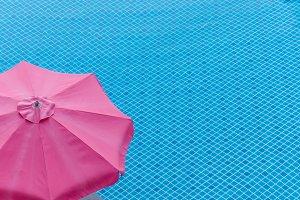 red umbrella on swimming pool