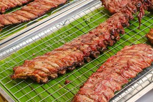 BBQ Pork Ribs on grille in market.