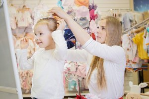 Mother and daughter try on different bows