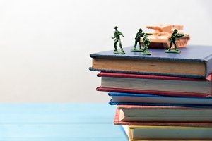 soldier toys on stack of book