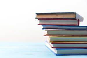 book stack on blue wooden table
